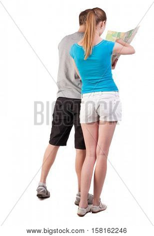 Back view journey of the young couple looking at the map. Rear view people collection.  backside view of person.  Isolated over white background. girl points a finger at the map the right way