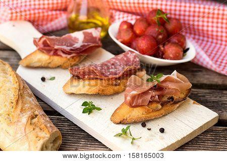 Italian ham dry cured prosciutto on bread toast bruschetta