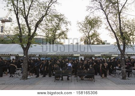 BANGKOK THAILAND - NOV 22 : stand in row of mourners in sanam luang for into Grand Palace while the funeral of king Bhumibol Adulyadej on november 22 2016