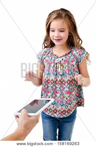Happy little girl is taking tablet pc isolated on a white education and internet concept