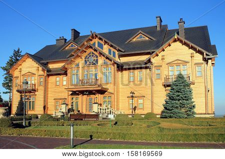 KYIV, UKRAINE - OCTOBER 29, 2015: Wooden Honka house in Mezhyhirya former private residence of ex-president Viktor Yanukovich now open to public, Kyiv region, Ukraine.