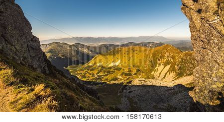 Mountain Landscape in Light of Setting Sun. View from Mount Dumbier in Low Tatras Slovakia. West and High Tatras Mountains in Background.