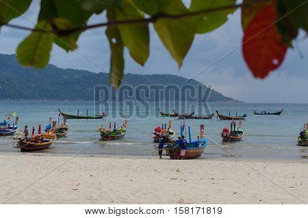 RAWAI BEACH PHUKET ISLAND THAILAND - FEBRUARY 28 2016: long tailed boat at exotic Bay of Rawai in Phuket island Thailand