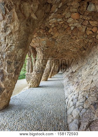 Park Guell in Barcelona. Stone vaulted passage supporting central terrace