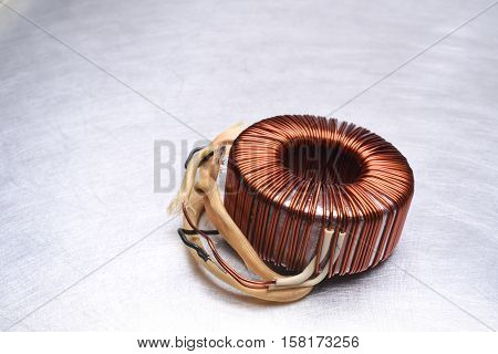 Copper Coil Transformer on Metal Background with Copy Space