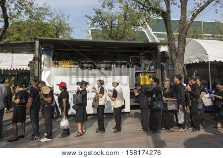 BANGKOK THAILAND - NOV 22 : line up of people for take donation in Sanam Luang while the funeral of king Bhumibol Adulyadej in Grand Palace on november 22 2016