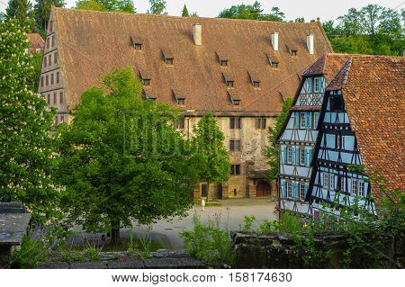 MAULBRONN, GERMANY - MAI 17, 2015: row of Tudor style houses at the monastery courtyard in Maulbronn. Cistercian Monastery Maulbronn is part of the UNESCO World Heritage Site.