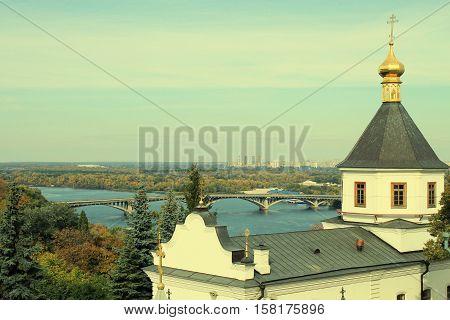 panoramic city view of Dnipro and Kyiv-Pechersk Lavra, Kyiv, Ukraine. Toned image