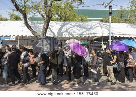 BANGKOK THAILAND - NOV 22 : people stand in row for take donation in Sanam Luang while the funeral of king Bhumibol Adulyadej in Grand Palace on november 22 2016