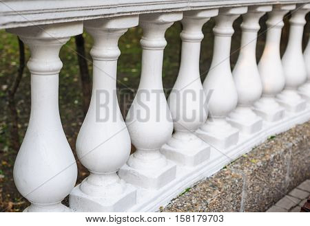 white balusters made of cement, architectural element.