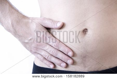 Attack of appendicitis. Pain in the right side. Attack of appendicitis. Pain the right side of the abdomen close-up image.