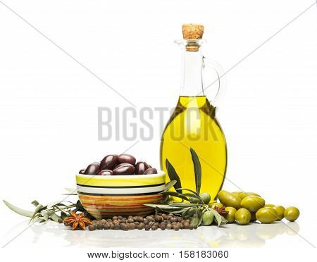 Bottles of Olive Oil with Olives and Spices