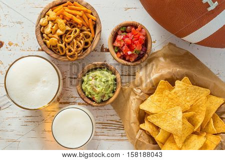 Football party food, super bowl day, nachos salsa guacamole, copy space
