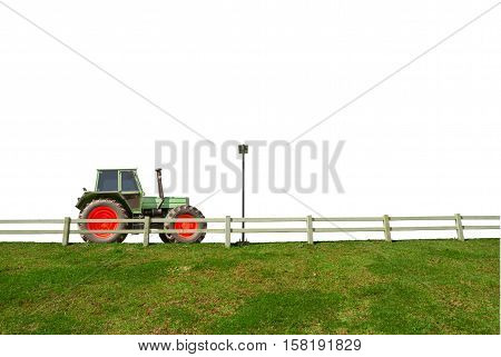 Tractor Parked On The Road With White Fence