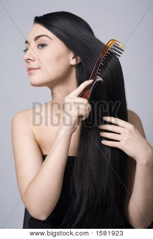 Woman Doing Her Beautiful Dark Hair