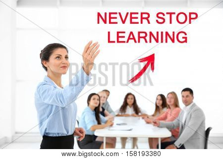 Business trainer at conference. Business coaching and development concept. Text NEVER STOP LEARNING.