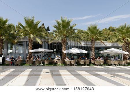MALAGA SPAIN - SEPTEMBER 3: People sitting at restaurant in Port of Malaga Spain