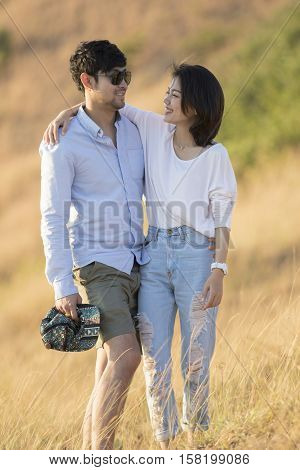 portrait of asian younger man and woman relaxing vacation at sea side happiness emotion