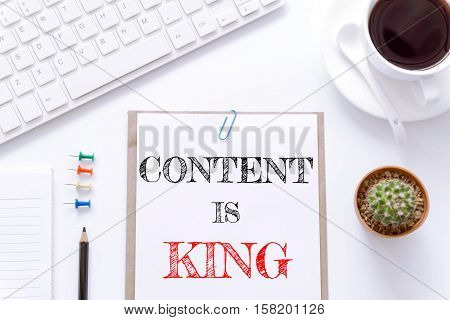 Text Content is king on white paper background / business concept