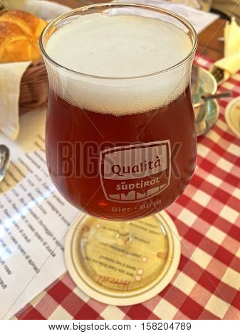KLAUSEN, ITALY - SEPTEMBER, 2016 : Home brew sweet Chestnut beer during Autumn in Klausen, Italy on September 24, 2016. It is brewed in Gasslbrau, traditional South Tyrolean public house brewery