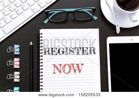 Text Register now on white paper background / business concept