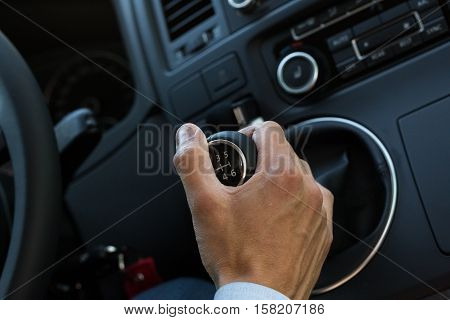Closeup of a Businessman's Hand on Gear Shift