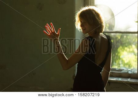 Night of the Revenge, Ghost in Haunted House, Mysterious Woman in White Dress Standing in Abandon Building, Horror Background For Halloween Concept and Book Cover Ideas