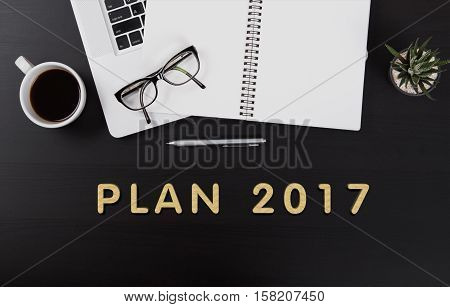 Modern Office desk with Plan 2017 homepage on the table business planing concept.