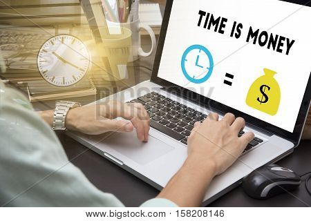 businessman using on computer laptop with Time is money business investment make money concept.