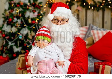Little Baby In The Arms Of Santa Claus