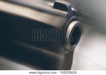 Gun Barrel Close Up.  Weapon Motion Blur Background.