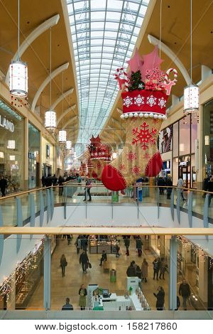 Cardiff Wales United Kingdom - November 23 2016: Locals and tourists are shopping in St David's Centre Cardiff adorned with beautiful Christmas decoration.