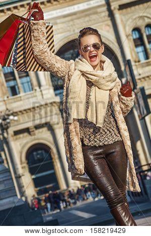 Happy Woman At Piazza Del Duomo In Milan, Italy Rejoicing
