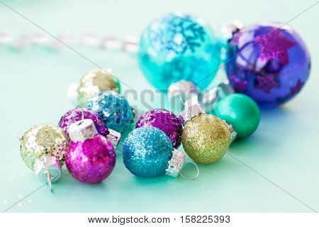 Colorful glittery christmas baubles made of glass