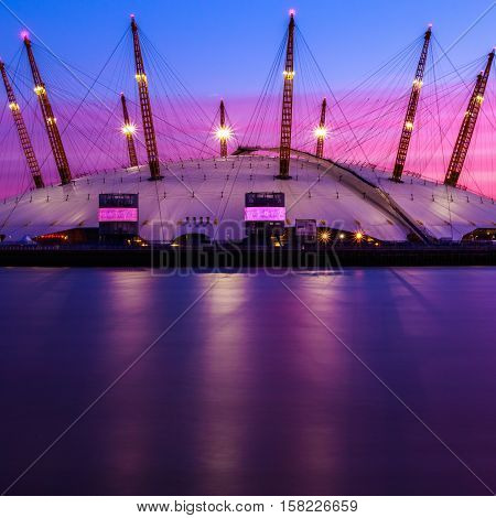 The O2 Arena at sunset against purple sky