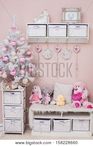 Christmas delicate colors living room with decorated shabby chic tree and plush toys