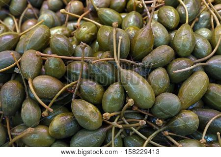 Green Pickled Big Capers Close Up Background