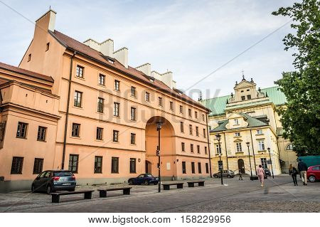 WARSAW POLAND - SEPTEMBER 27: View of the Dziekanka Inn - historic building in Warsaw and the Carmelite Church from northwest Krakowskie Przedmiescie in Warsaw Poland on September 27 2016