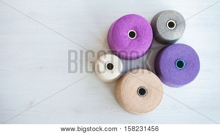 skeins of wool on background gray wood