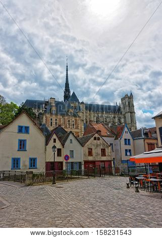 Amiens Cathedral of Notre Dame and traditional houses on Rue de Don Street at the embankment of Somme canal Picardy France