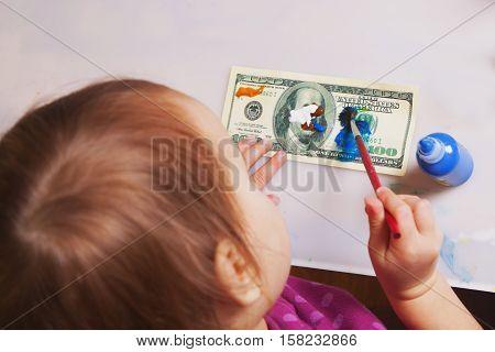Making fake dollars. Drawing process of counterfeit money (humorous photo)