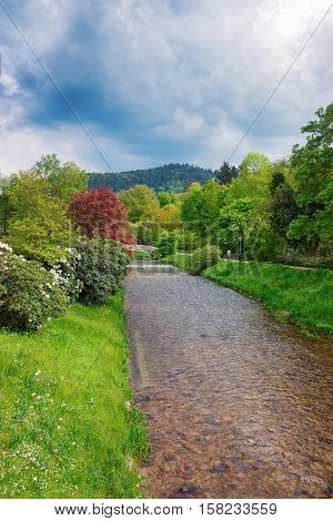 Bridge and river at Lichtentaler Allee park in Baden-Baden Baden-Wurttemberg in Germany. Baden Baden is a spa town.