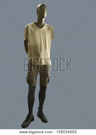 Male mannequin dressed in casual clothes (t-shirt and shorts). Isolated on gray background.