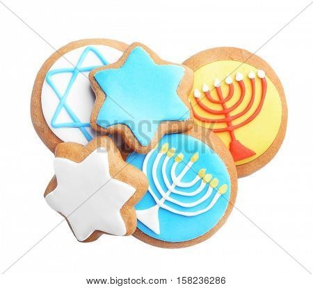 Tasty glazed cookies for Hanukkah, on white background poster
