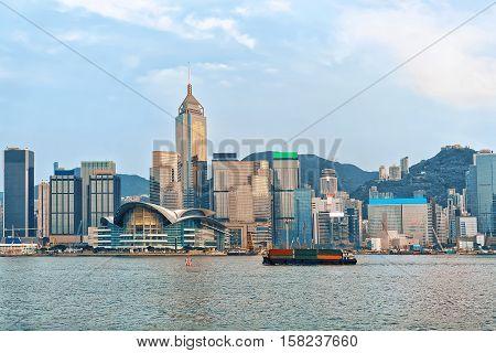 Container Ship At Victoria Harbor Of Hong Kong At Sunset
