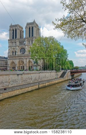 Dame De Paris Cathedral Boat And Seine River Embankment