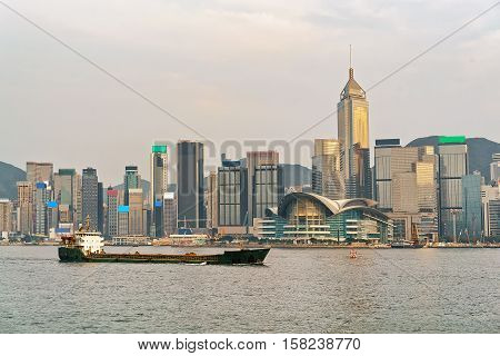 Dry Cargo Vessel And Victoria Harbor In Hong Kong Sunset
