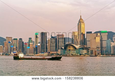 Dry Cargo Vessel At Victoria Harbor In Hong Kong Sunset