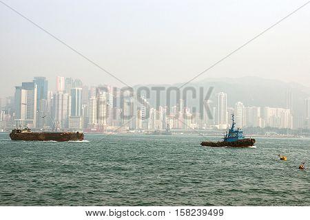 Fisher Boat At Victoria Harbor In Hong Kong