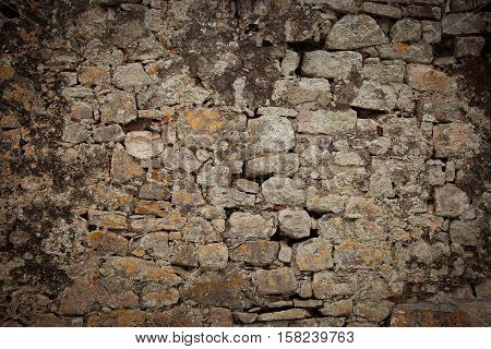 Ancient wall of gray color from different stones